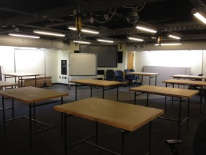 Studio classroom and wood-topped, steel-frame work tables.