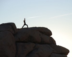 """Joshua Tree yoga - warrior 1a"" by © Jarek Tuszynski / Wikimedia Commons. Licensed under CC BY-SA 3.0 via Wikimedia Commons - http://commons.wikimedia.org/wiki/File:Joshua_Tree_yoga_-_warrior_1a.jpg#mediaviewer/File:Joshua_Tree_yoga_-_warrior_1a.jpg"